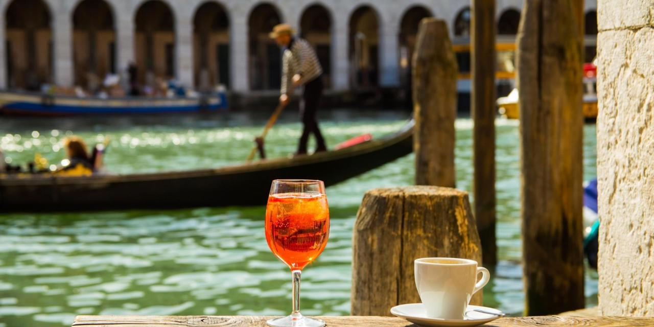 Coffee and traditional Venetian Spritz on the shore-side on a sunny Italian day